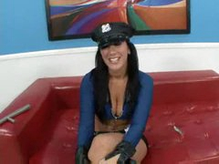 Busty cop in boots and low cut top sucks cock