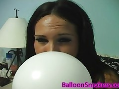 Kitty Bella likes to blow a balloon till it pops