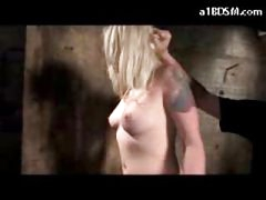 Blond Girl Whipped During the time that Washing The Dungeon Floor Getting Fastened Spanked To Red With Stick