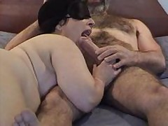 Masked obese mature wife gives good sucking and licking  to her bushy hubby\'s large dick - short but enjoyable