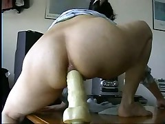 Watch this masked British play around on video with her boyfriend.  First this babe widens her goods to show what this babe has to suggest before this babe straddles a massive dildo up her ass.  Listen to her wince as this babe tries to acquire it up as far as this babe can take it up the pooper.  She's a real trooper as this babe does what her boyfriend tells her to do with the dildo.  Great way to educate her for anal.