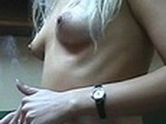 Lecherous blonde honey with diminutive sticking wobblers walks nude in her room filmed by her boy-friend with dilettante web camera in his hands. This dude doesn't like her smoking but really enjoys her hot nude body shyly overspread by New Year tree decoration :)