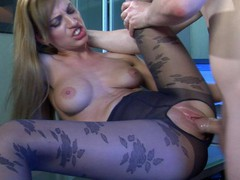 Oversexed cutie in flower pattern pantyhose getting a leg over in the office