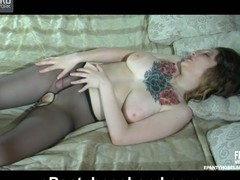 Tattooed sweetheart clad in crotchless barely black hose fucking a rubber dong