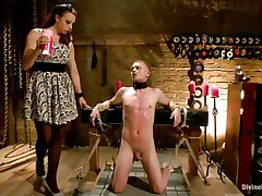 Micah Andrews is tied up so that stud can't move during the time that mistress Chanel Preston oozes hot candle wax all over his body. This playgirl oozes the wax on his chest, tongue, and strapon and balls. After choking him until that stud gasps for air, that playgirl whips his petite strapon red.