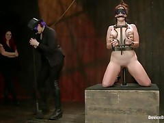 And so is a kinky session of bdsm! This doxy stays in her knees all tied up and with her love love bubbles squeezed while her mistress, just like she is, has a blindfold around her eyes. The mistress spanks the doxy with an electric wand and the rest is for you to see and have a enjoyment it!