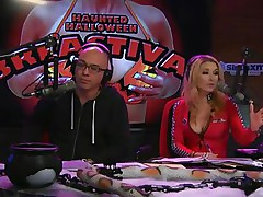 On Playboy Radio's Morning Show, 3 dressed-up hotties are racing against the clock to make a ghost costume. The in-studio guest is acting as a judge as well but the angels are having trouble. The male host goes to aid and the winner is the short cutie who cut out breast holes in her sheet.