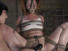 This is how these gals like to play. Cici is all tied up and has a mask on her face while her dark brown girl takes advantage of her body. That playgirl squeezes her nipps and tongue and then begins rubbing that enjoyable cum-hole with a vibrator.