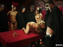 See Devon, the golden-haired breasty floozy getting served in the dining table to please those guests at the party. The fetish guest, wearing masks getting amused by looking at her moist body full of curves. They played with her bog boobs and then shoved their hard rods unfathomable in her mouth to get some admirable blowjob!