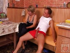 Aged mother and the Son&amp,#039,s ally have a wonderful time on kitchen.