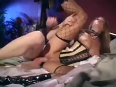 Sexy brunette in hot fishnet stockings receives drilled in the wazoo